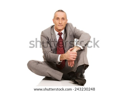 Businessman sitting on the floor.