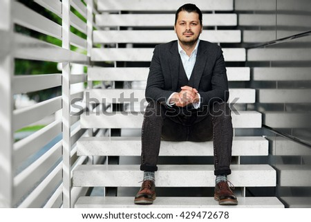 Businessman sitting on the stairs.