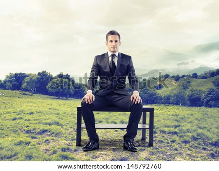 businessman sitting outdoors - stock photo