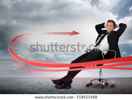 Businessman sitting with red arrow going past him smiling at camera in swivel chair