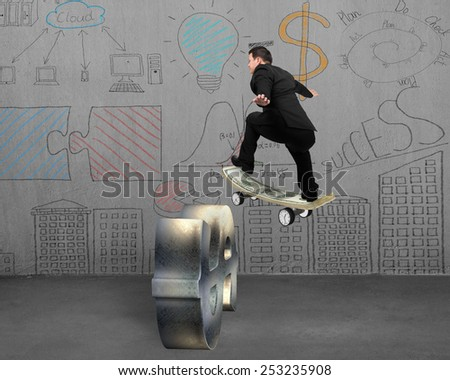 Businessman skating on money skateboard across metal dollar sign with business concept doodles wall background - stock photo