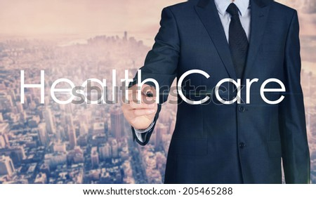 Businessman sketching and writing Health Care with nice business city background in retro colors. - stock photo
