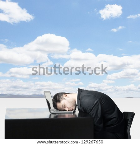 Businessman sleep at laptop on background of nature