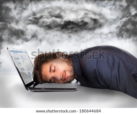 businessman sleep at office desk with dark storm cloud, business man crisis concept problem, negative emotion, closed eyes lying head on laptop - stock photo