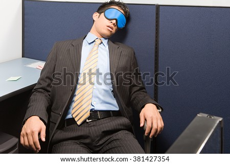 Businessman sleeping - stock photo
