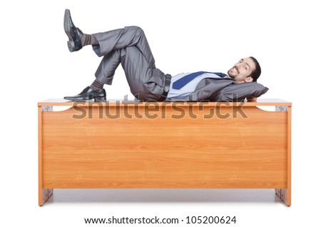 Businessman sleeping at this desk - stock photo