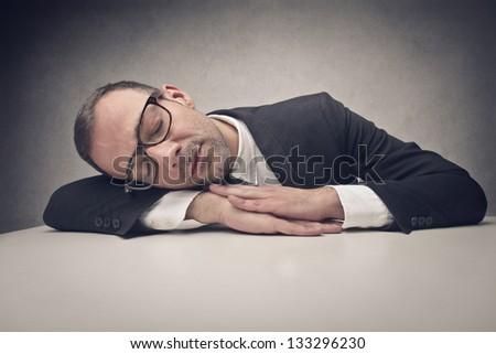 businessman sleeping at work - stock photo