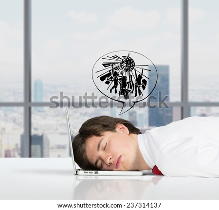 businessman sleeping on the job and dreams of entertainment