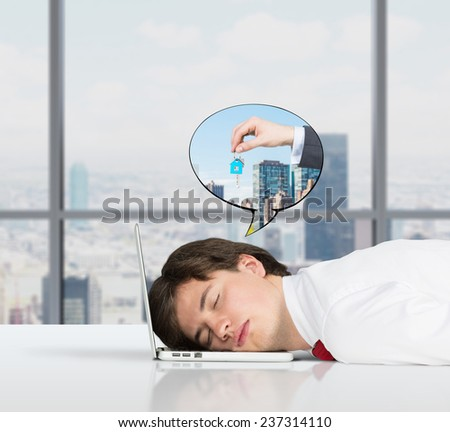businessman sleeping on the job and dreams of sale real estate
