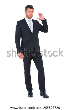 Businessman smiling with hand up on white background