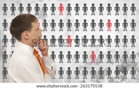 Businessman solves the problem of layoffs - stock photo
