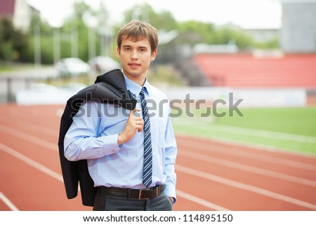 Businessman sport manager and executive at athletic stadium and race track - stock photo