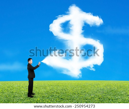 Businessman spraying dollar sign shape cloud paint with sky grass background