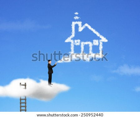 Businessman spraying house shape cloud paint with ladder and sky background - stock photo
