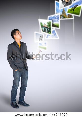 businessman stand look digital image from smartphone