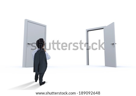 Businessman standing against closed and open doors