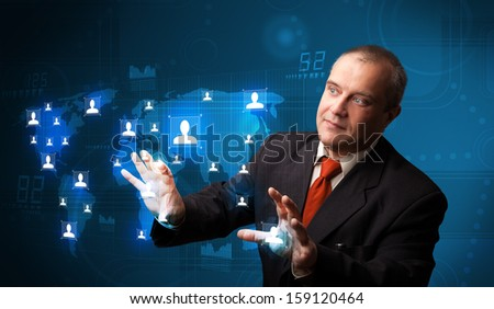 Businessman standing and choosing from social network map