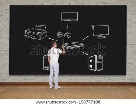 businessman standing and drawing scheme computer network - stock photo