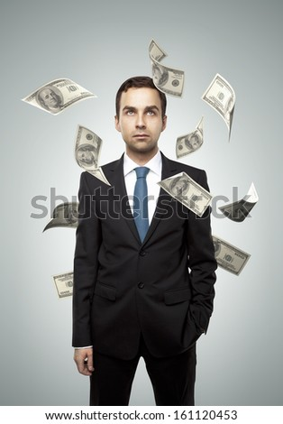 businessman standing and falling dollar
