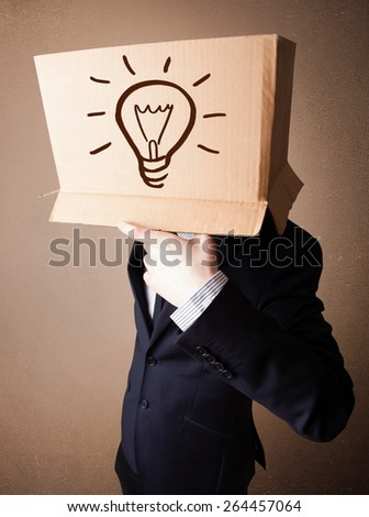 Businessman standing and gesturing with a cardboard box on his head with light bulb - stock photo
