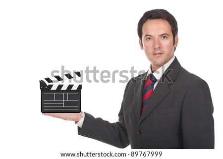businessman standing and holding clapboard on his hand - stock photo