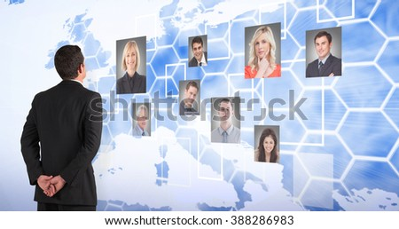 Businessman standing and looking against background with europa map