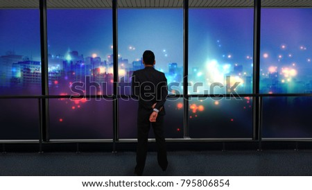 Businessman standing and looking at night city, Business vision concept