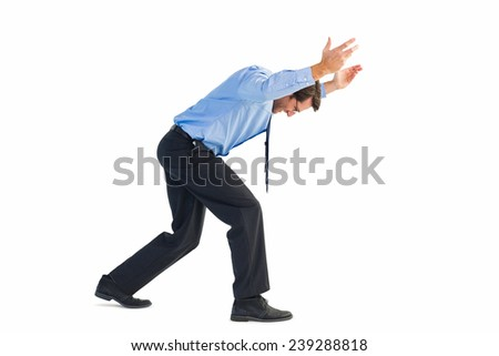 Businessman standing and pushing up on white background