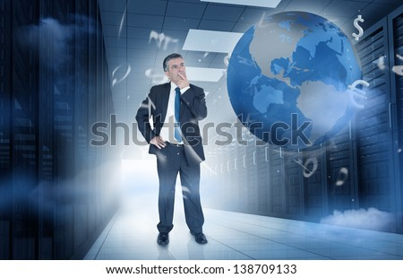 Businessman standing and thinking in data center with currency graphics and earth