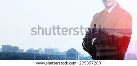 businessman standing and thinking on buildings backgrounds, double exposure - stock photo