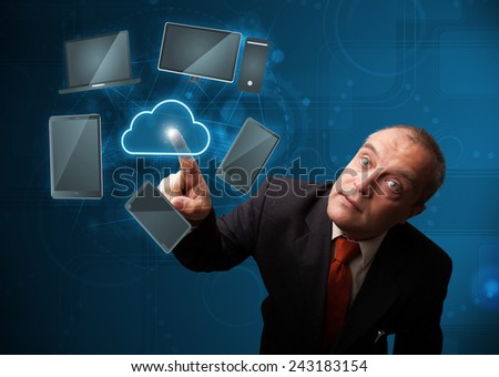 Businessman standing and touching high technology cloud service - stock photo