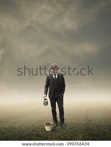 Businessman Standing and Watering Plant in Flower Pot-Business Growth Concept