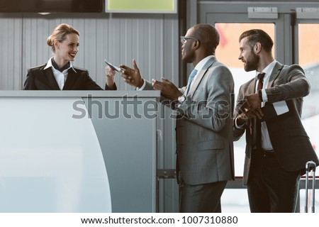 businessman standing at airport check in counter, hurry up on plane concept