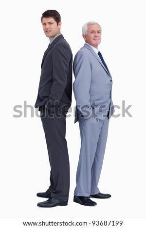 Businessman standing back to back with his mentor against a white background