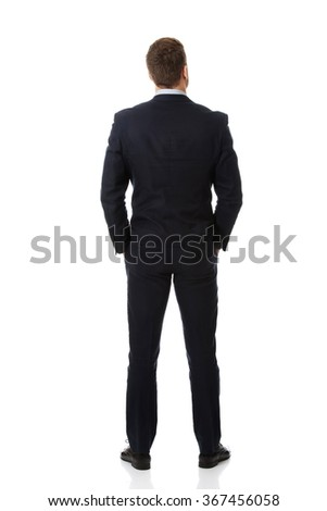 Businessman standing back to camera. - stock photo
