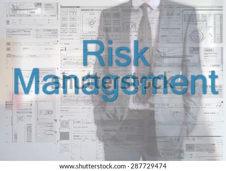 Businessman standing behind transparent board with diagrams and text Risk Management - stock photo
