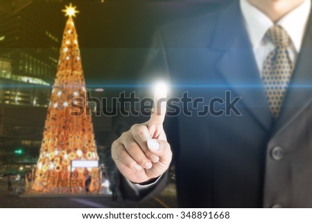 Businessman standing hand touch screen. You can add text to your ad. - stock photo