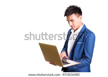 Businessman standing, holding laptop computer in hand, working.