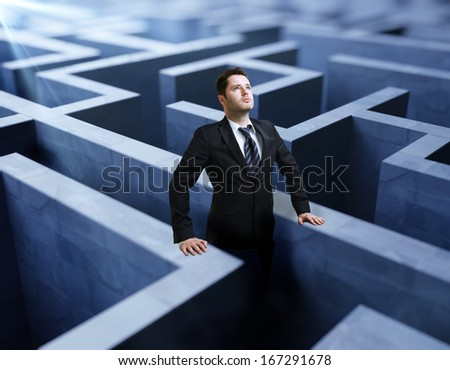 businessman standing in a maze - stock photo