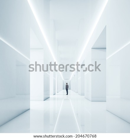 businessman standing in bright office - stock photo