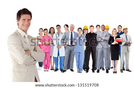 Businessman standing in front of different types of workers on white background - stock photo