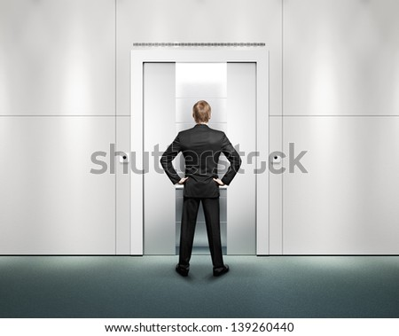 businessman standing in front of elevator