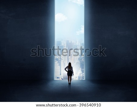 businessman standing in front of the huge gate - stock photo