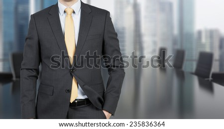 businessman standing in modern office, close up - stock photo