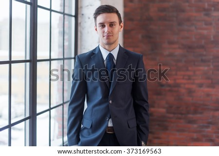 Businessman standing in office. Manager director boss entrepreneur employer.