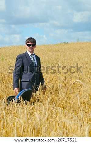 businessman standing in the middle field