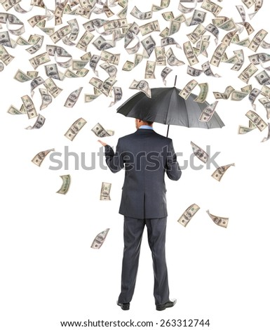 Businessman standing in the rain of money - stock photo