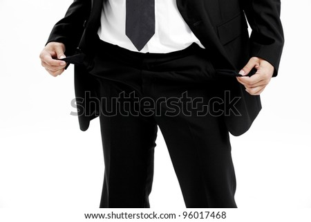 businessman standing isolated on the white background and showing his empty pocket, turning his pocket inside out, no money - stock photo