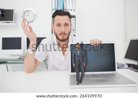 Businessman standing looking at camera against confused computer engineer looking at camera with laptop