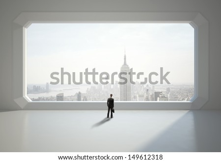 businessman standing near big window - stock photo